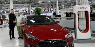 Tesla Motors CEO Elon Musk with Indian Prime Minister Narendra Modi standing next to a Tesla EV