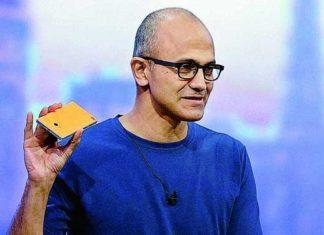 Microsoft CEO Satya Nadella holding a Nokia phone