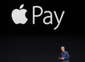 Tim Cook, chief executive officer of Apple Inc., unveils Apple Pay during a product announcement at Flint Center in Cupertino, California, U.S., on Tuesday, Sept. 9, 2014. Apple Inc. unveiled redesigned iPhones with bigger screens, overhauling its top-selling product in an event that gives the clearest sign yet of the company's product direction under Cook. Photographer: David Paul Morris/Bloomberg *** Local Caption *** Tim Cook