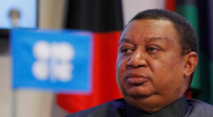 OPEC Secretary-General Barkindo listens during a news conference in Vienna