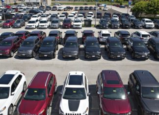 New car inventory in a parking lot